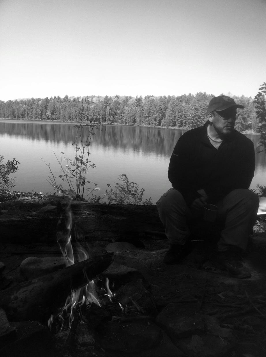 Photo of Paul on Rowan Lake, Algonquin, Canada, taken surreptitiously. by one of his sons.